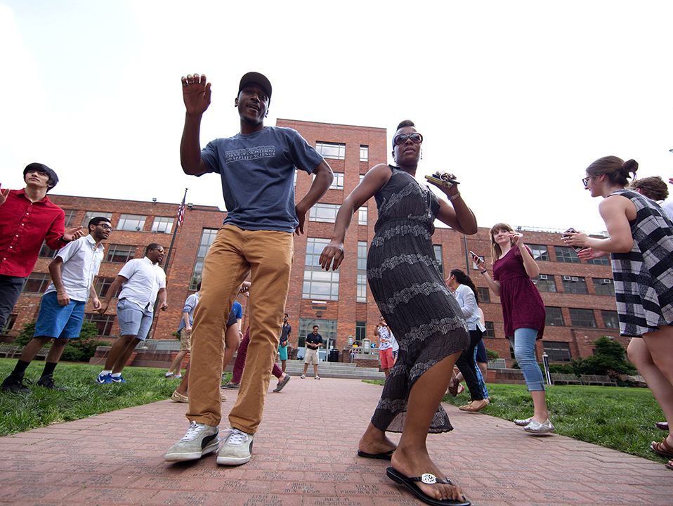 Employees dance at the Proud to Be GW festival