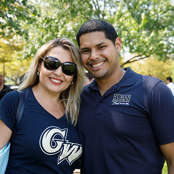 Two GW Employees Outside Smiling